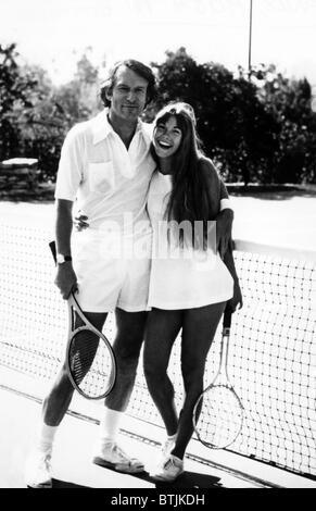 Hugh Hefner and Barbi Benton pose for a cover shot for 'Tennis Magazine'. ca 1972. Courtesy CSU Archives/Everett - Stock Photo