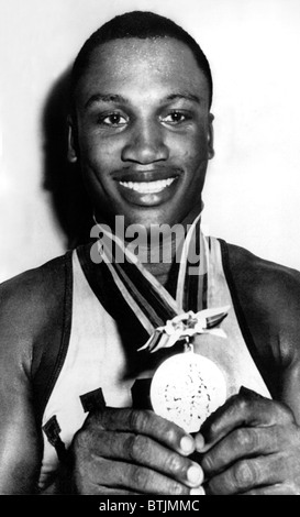 Joe Frazier holding Olympic heavyweight gold medal, Tokyo, 10/23/1964 - Stock Photo