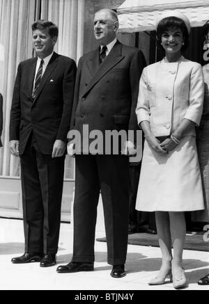 John F. Kennedy, French President Charles de Gaulle, and Jacqueline Kennedy stand on the steps of the Elysee Palace, - Stock Photo