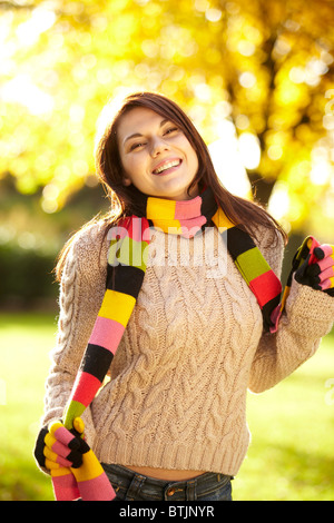 Girl wearing jumper and scarf - Stock Photo