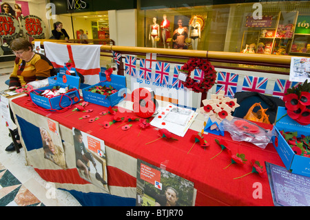 Royal British Legion Poppy Stall With A Volunteer - Stock Photo