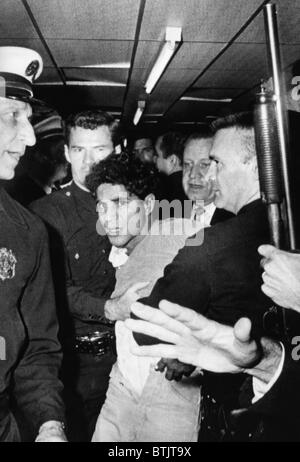 Sirhan Sirhan, the suspect in the shooting of Senator Robert F. Kennedy, being hustled out of the Ambassador Hotel, - Stock Photo