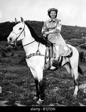 Dale Evans (1912-2001), American actress, singer and wife of Roy Rogers, with her horse Buttermilk, circa 1956. - Stock Photo
