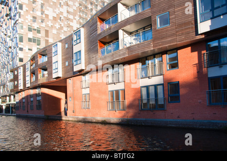 Apartments on the canal next to new 'Cube' building in Birmingham, UK - Stock Photo