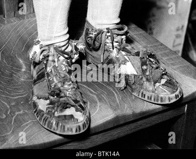 Sneakers, (School publicity shot supporting PTA's replacement of worn shoes), circa 1940-1950's - Stock Photo