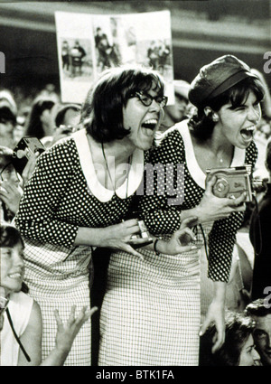 BEATLES FANS scream at a concert at Shea Stadium, NY, 8/15/65, displaying what is called, 'Beatlemania.' - Stock Photo