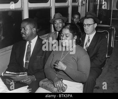 Martin Luther King and others take a seat in the front of the bus in Montgomery, Alabama, on Dec. 21, 1956, at the - Stock Photo