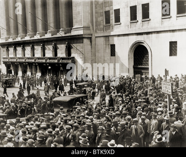 Crowd gathers outside the New York Stock Exchange during the Crash of October 1929. - Stock Photo