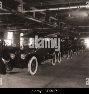 Row of Cadillac touring cars come off the assembly line in 1917. Cadillac was purchased by General Motors in 1909, - Stock Photo