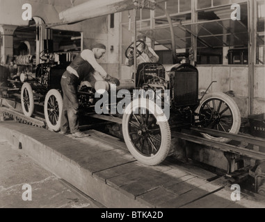 Ford Model Ts on the moving assembly line, first used by the Ford Motor Company in 1913. - Stock Photo