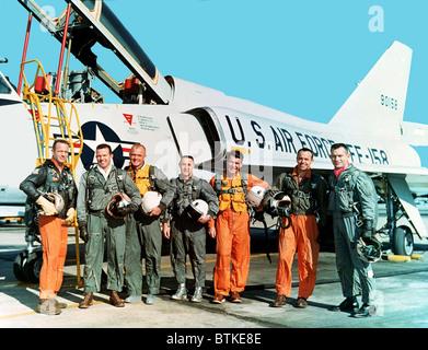 Original seven Project Mercury astronauts standing beside a Convair 106-B aircraft. Left to right, M. Scott Carpenter, - Stock Photo