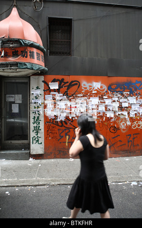 A wall with notes in the street, New York City, USA - Stock Photo