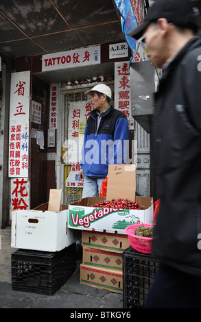 A fruit and vegetable seller in Chinatown, New York City, USA - Stock Photo