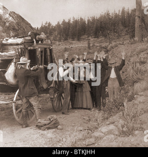 Reenactment of a stage coach robbery by two men, who shot a man who lies on top of the coach and are robbing the - Stock Photo