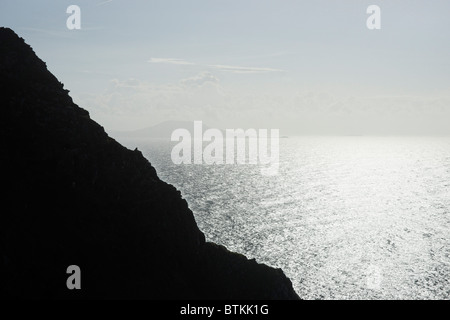 Silhouetted sea cliffs near Keem, Achill Island, County Mayo, Connaught, Ireland. - Stock Photo