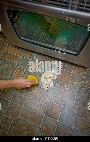 Cleaning Up Mess In Kitchen - Stock Photo