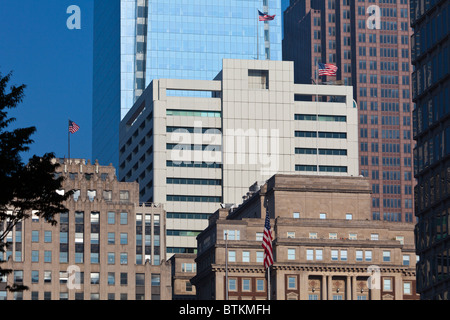 old and new skyscrapers in Philadelphia with American flags - Stock Photo