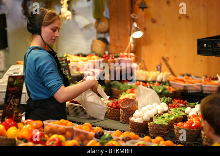 Beautiful Amish girl selling local products at St. Jacobs farmers' market in Ontario Canada - Stock Photo