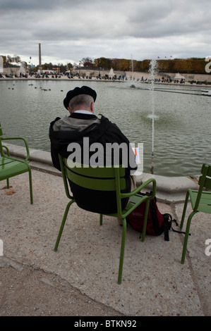 Paris, France - Tourists Sitting in Garden Pond, with Pubic Water Fountain, 'Jardin des Tuileries', Outside in Urban - Stock Photo