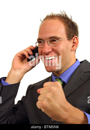 A smart businessman gets a surprising telephone call. All isolated on white background.