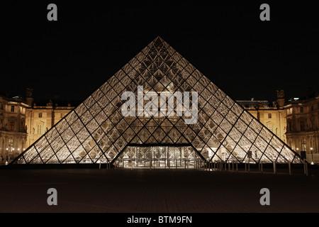 The Louvre pyramid,Paris, France,at night. - Stock Photo