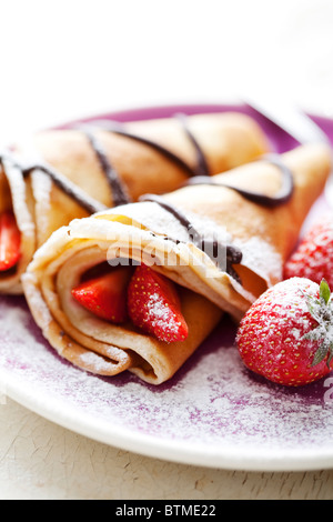 crepes with strawberries and chocolate - Stock Photo