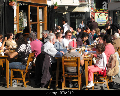 ISTANBUL, TURKEY. Customers eating lunch at a restaurant in the Galata district of Beyoglu. 2010. - Stock Photo