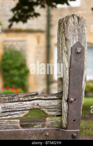 The village stocks in the Cotswold village of Stow on the Wold Gloucestershire UK - Stock Photo