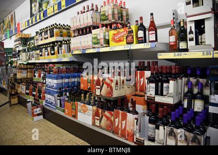 UK, Europe. Bottles of wine for sale in boxes on supermarket shelves - Stock Photo