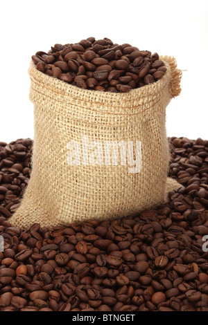 Coffee beans in burlap sack - Stock Photo