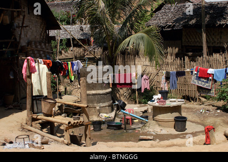 The common bathing area for Karen Paduang refugees from Burma (Myanmar) at a refugee camp in Mae Hong Son province - Stock Photo