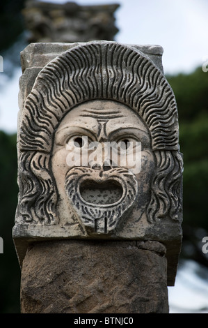 Stone mask in the ancient theater. Ostia Antica, Rome, Italy - Stock Photo
