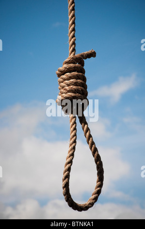 Hangman's noose against a blue and cloudy sky - Stock Photo