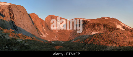 alpenglow on the cliffs of Wind River Peak and Little El Capitan in the Wind River Range of Wyoming - Stock Photo