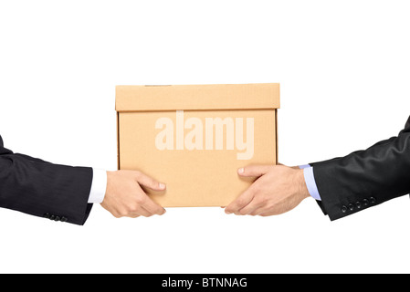 A businessman delivering a paper box to a man - Stock Photo