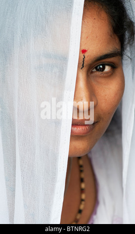 Young Indian woman in a white veil portrait. India - Stock Photo