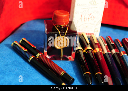 J. Herbin 1670 anniversary ink with Pelikan, Sailor, and vintage Sheaffer fountain pens - Stock Photo