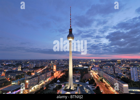 Berlin. Germany. Dusk view of the Berlin skyline with Fernsehturm (TV Tower) Alexanderplatz. - Stock Photo
