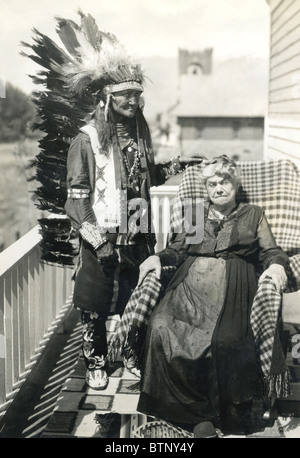 Late 1800's or early 1900's photograph showing an Indian Chief in full headdress standing next to an older elderly - Stock Photo