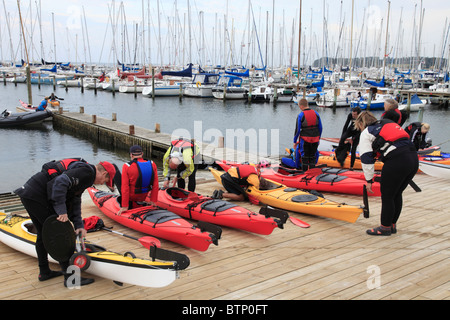 people of an Danish sports club canoeing with single seater canoes on the Baltic Sea - Stock Photo