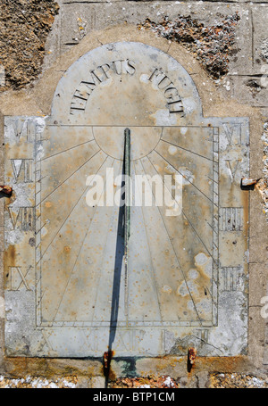 ' Tempus Fugit ' carved on an old sun dial - Stock Photo