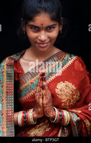 Indian girl wearing traditional silk sari with henna prayer hands. India - Stock Photo