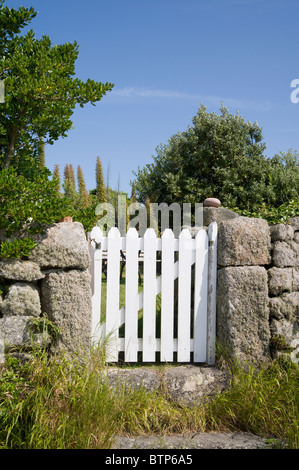 White gate on St. Agnes, Isles of Scilly, UK. - Stock Photo