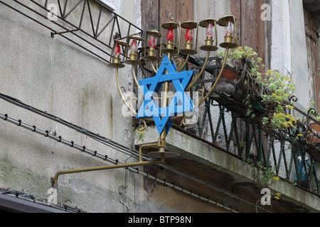 Jewish Menorah lights with Star of David sign in Venice's Jewish quarter - Stock Photo