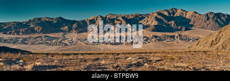 Mojave Desert and Owlshead Mts over Confidence Hills sunrise from Harry Wade Road in Death Valley National Park, - Stock Photo
