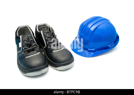 Isolated safety shoes and blue helmet for workers - Stock Photo