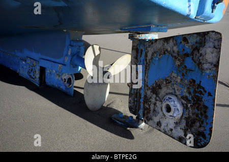Hull view of a fishing boat propeller and rudder - Stock Photo