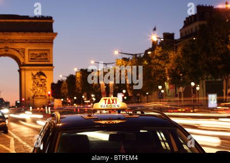 Paris taxi by the Arc de Triumph - Stock Photo