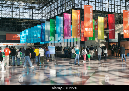 Attendees pick up tickets and prepare to enter Wired NextFest on Level 3 of the Jacob Javits Convention - Stock Photo