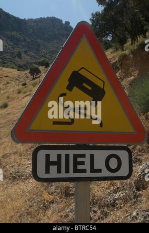 Slippery road sign, Spain - Stock Photo